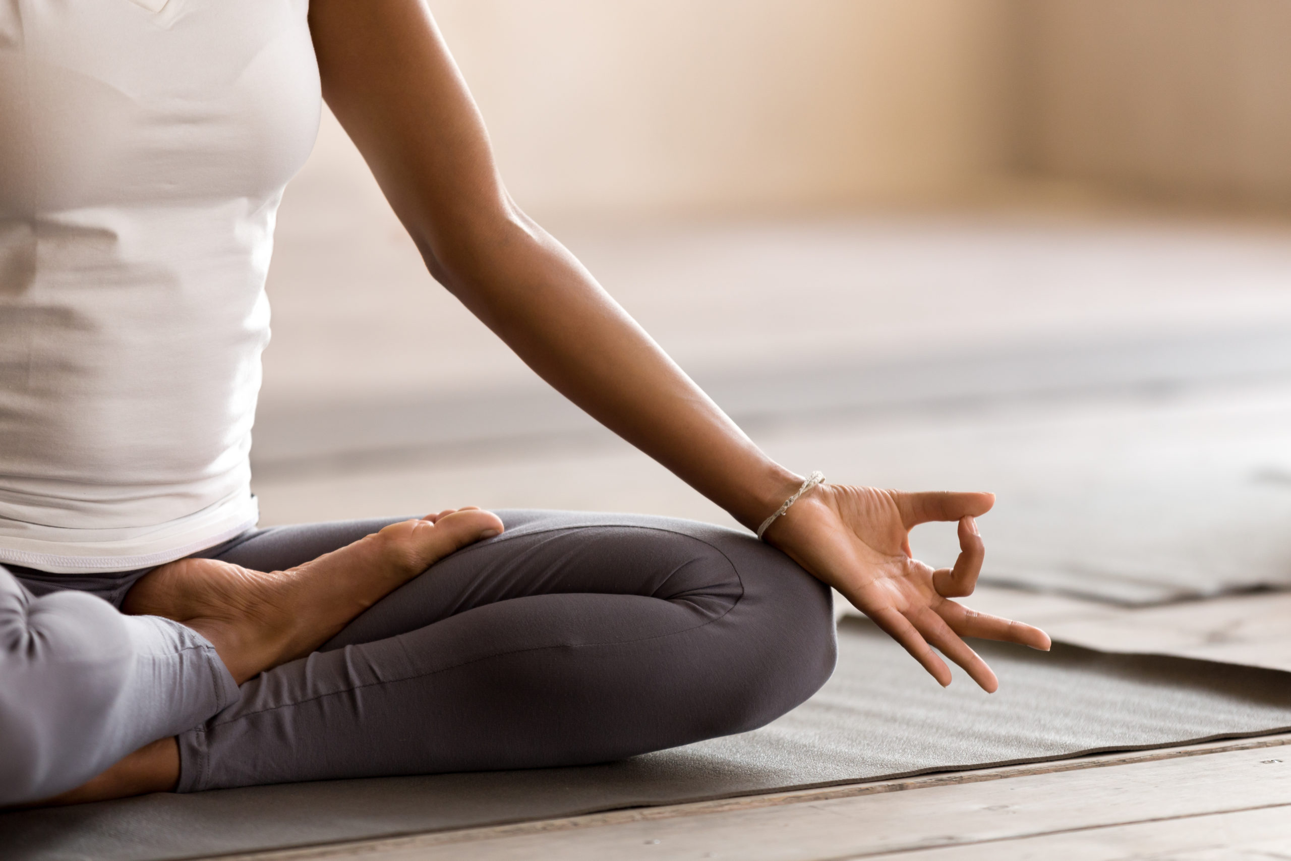 hand and foot of a meditating woman