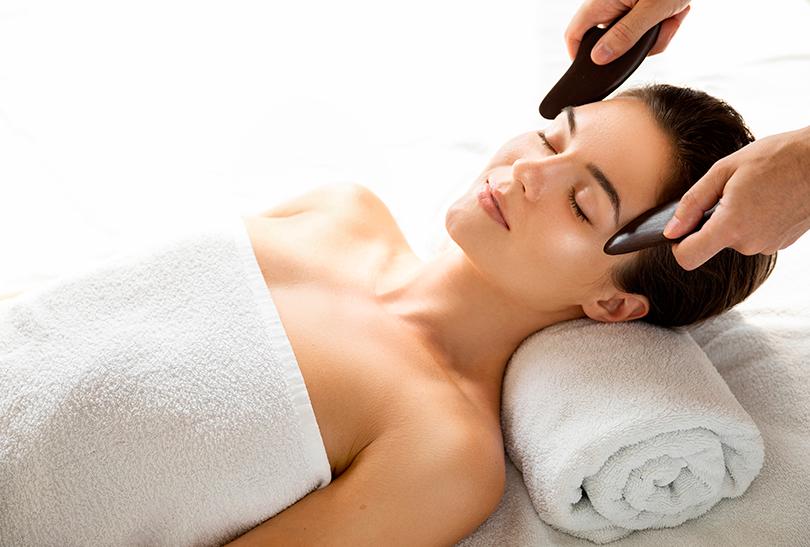 woman having a guasha therapy